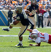 Pitt running back James Conner breaks loose from New Mexico cornerback Isaah Brown for a 38 yard touchdown run. The Pitt Panthers defeated the New Mexico Lobos 49-27 on Saturday, September 14, 2013 at Heinz Field, Pittsburgh, Pennsylvania.