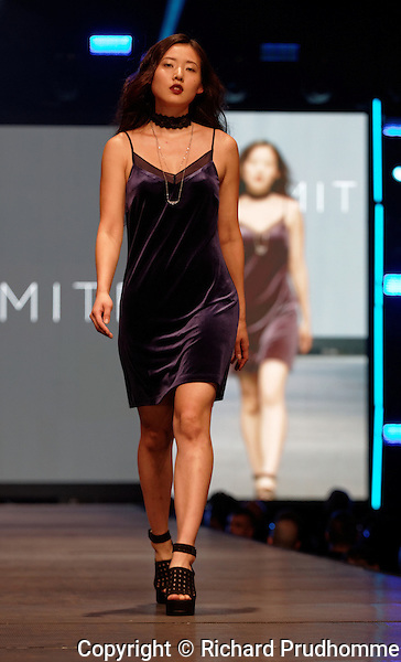 A model walks on the runway at the Dynamite fashion show held during the Fashion and Design Festival  in downtown Montreal.