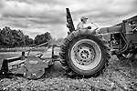 Keith Stewart from Keith Organic Farm in Port Jervis, New York on his tractor plowing the fields