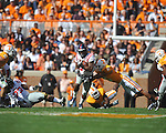 Ole Miss running back Brandon Bolden (34) runs past Tennessee defensive back Janzen Jackson (15) in a college football game at Neyland Stadium in Knoxville, Tenn. on Saturday, November 13, 2010. Tennessee won 52-14.