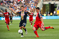 Antoine Hoppenot (29) of the Philadelphia Union and Logan Emory (2) of Toronto FC. The Philadelphia Union defeated Toronto FC 3-0 during a Major League Soccer (MLS) match at PPL Park in Chester, PA, on July 8, 2012.