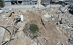 A giant bomb crater remains in Shejaiya, a neighborhood of Gaza City that was hard hit by the Israeli military during the 2014 war.