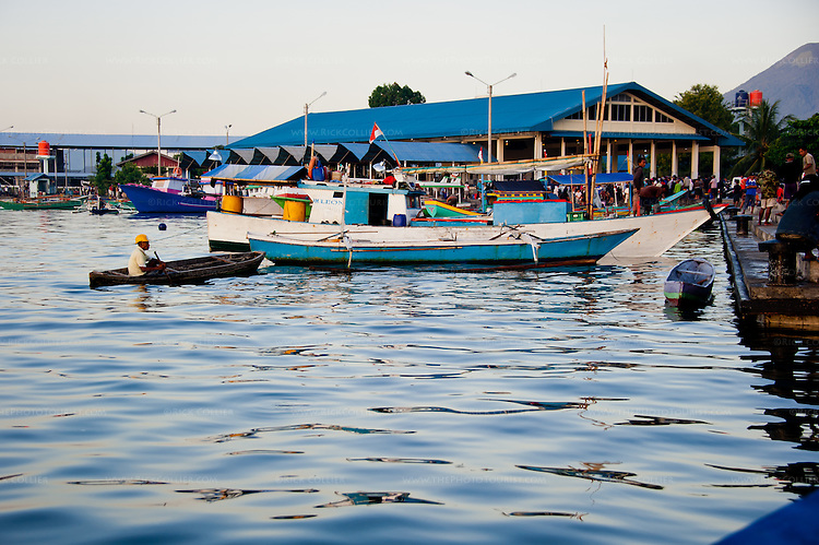 Small fishing boats throng the landing at the main fish market in Bitung, North Sulawesi, Indonesia.
