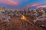 Asaro mudmen gather around a fire, Eastern Highlands Province, Papua New Guine