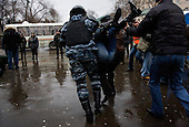 Members of Russia's OMON (Special Force) arrest peaceful protesters, who demonstrated in Moscow against what they said were rigged presidential elections..Russia went to the poll the day before to vote for Vladimir Putin's chosen successor, Dmitry Medvedev. .The protesters are part of a loose coalition of opposition members led by the former world chess champion Garry Kasparov and writer Eduard Limonov.