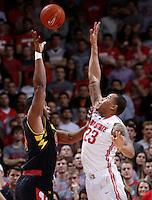 Ohio State Buckeyes center Amir Williams (23) tries to block a shot by Maryland Terrapins center Shaquille Cleare (44) in the second half of the college basketball game between the Ohio State Buckeyes and the Maryland Terrapins at the Jerome Schottenstein Center in Columbus, Wednesday evening, December 4, 2013. The Ohio State Buckeyes defeated the Maryland Terrapins 76 - 60. (The Columbus Dispatch / Eamon Queeney)