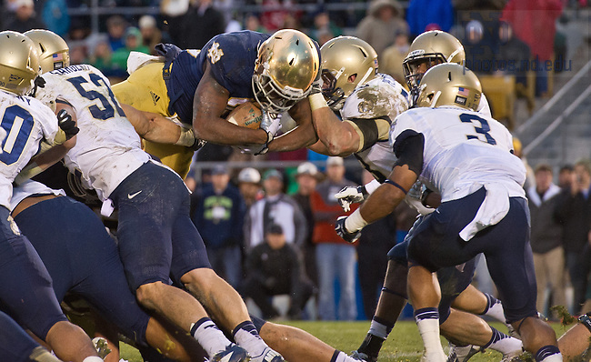 Nov. 2, 2013; Running back Tarean Folston (25) dives over the goal line for the game-winning touchdown against Navy.<br /> <br /> Photo by Matt Cashore