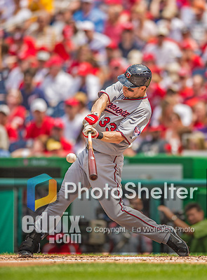9 June 2013: Minnesota Twins first baseman Justin Morneau connects against the Washington Nationals at Nationals Park in Washington, DC. The Nationals shut out the Twins 7-0 in the first game of their day/night double-header. Mandatory Credit: Ed Wolfstein Photo *** RAW (NEF) Image File Available ***