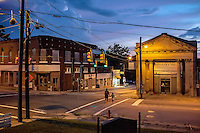 A summer storm rolls in over Angier Avenue and Driver Street in East Durham at sunset.