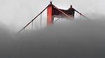 San Francisco fog creeps past the Golden Gate Bridge.