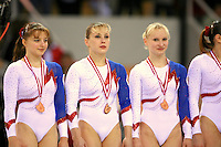 Oct 18, 2006; Aarhus, Denmark; (L-R) Anna Pavlova, Elena Zamolodchikova, Svetlana Klyukina of team Russia  celebrate winning bronze in women's team final competition at 2006 World Championships Artistic Gymnastics.