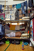 A worker's dormitory that houses mostly migrants from Bangladesh and India. Many such accommodations are illegal, have very poor security and hygiene and are usually overcrowded.