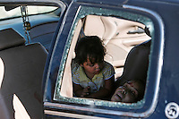06/02/2010..Twenty-one year-old Maria de Jesus Magallanes lays in the back of the vehicle as she waits for the ambulance to arrive. Her 3-year-old daughter watched over her during the full hour it took the ambulance to arrive at the scene. Maria's husband was wounded and taken by the same armed men who shot her in the abdomen.