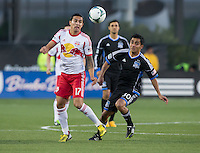 March 10th, 2013: Tim Cahill and Rafael Baca eyeing for the ball during a game at Buck Shaw Stadium, Santa Clara, Ca.   Earthquakes defeated Red Bulls 2-1
