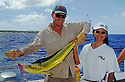 Marshall Islands, Micronesia: Fishing Guide Rod Bourke and Japanese visitor Yuki Nakako with Mahimahi caught at Bikini Atoll.