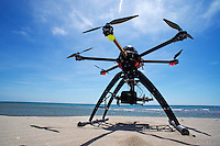 Digital camcorder on a Unmanned Aerial Vehicle (UAV or Drone), with six rotors, used for aerial photography or filming, beach, France