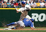 Seattle Mariners shortstop Willie Bloomquist (8)  forces out Texas Rangers'  baserunner Adam Rosales (9) and tries for a double play  at SAFECO Field in Seattle on April 10, 2015.  The Mariners came from behind to beat the Rangers 11-10.  Jim Bryant Photo. ©2015. All Rights Reserved.