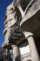 Iron balconies ; undulating corners with closed balconies, Entrance Façade, La Pedrera (Casa Milà), Barcelona, Catalonia, Spain, built by Antoni Gaudí (Reus 1852 ? Barcelona 1926), 1906 - 1910, for the Milà Family, with Josep Maria Jujol as architect collaborator and with Joan Beltran as a plaster. One of the main Gaudi residential buildings. Picture by Manuel Cohen