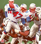EAST RUTHERFORD, N.J. 12/27/98 --1227JH01.tif--The Patriots' number 47 Robert Edwards fumbles away the ball, which was recovered by the Jets' Ray Mickens for the first-half turnover. JOHN HARVEY staff photo for Roger C. story.