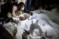 A relative mourns a child after a river ferry carrying more than 100 passengers capsized in the River Padma Sunday after being hit by a cargo vessel at Paturia, in Manikganj district, about 80 kilometers  northwest of Dhaka, Bangladesh. Feb. 22, 2015