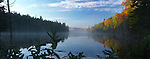 Mist over Smoke lake at dawn. Beautiful panoramic fall nature scenery. Algonquin Provincial Park, Ontario, Canada.