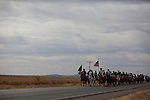 Horse riders ride north from Palomas, Mexico in a parade celebrating the anniversary of the invasion of Pancho Villa in 1916in Columbus, New Mexico. Recently federal authorities arrested the mayor, police chief, and trustees who were allegedly operating an illegal gun running ring.