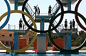 Iraqi children try to beat high summer temperatures by taking turns jumping from a former Iraq Olympic Committee diving center platform August 19, in the Northern Iraqi city of Mosul.