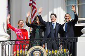 U.S. President Barack Obama (R), Prime Minister of Canada Justin Trudeau (C-R), U.S. First Lady Michelle Obama (C-L), and spouse of the Prime Minister of Canada Sophie Gr&eacute;goire Trudeau (L), wave from the balcony of the White House, in Washington, DC, USA, 10 March 2016. This is the first official visit of Prime Minister of Canada Justin Trudeau to the White House. <br /> Credit: Jim LoScalzo / Pool via CNP