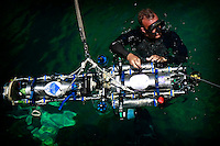 TRANSEC Sonar Test Basin, Point Loma, San Diego, CA, USA.Friday, August 1 2008.  US NAVY Diver Martin Stacy releases an Autonomous Underwater Vehicle bulit by students at the Kyushu Institute of Tecnolgy Japan.