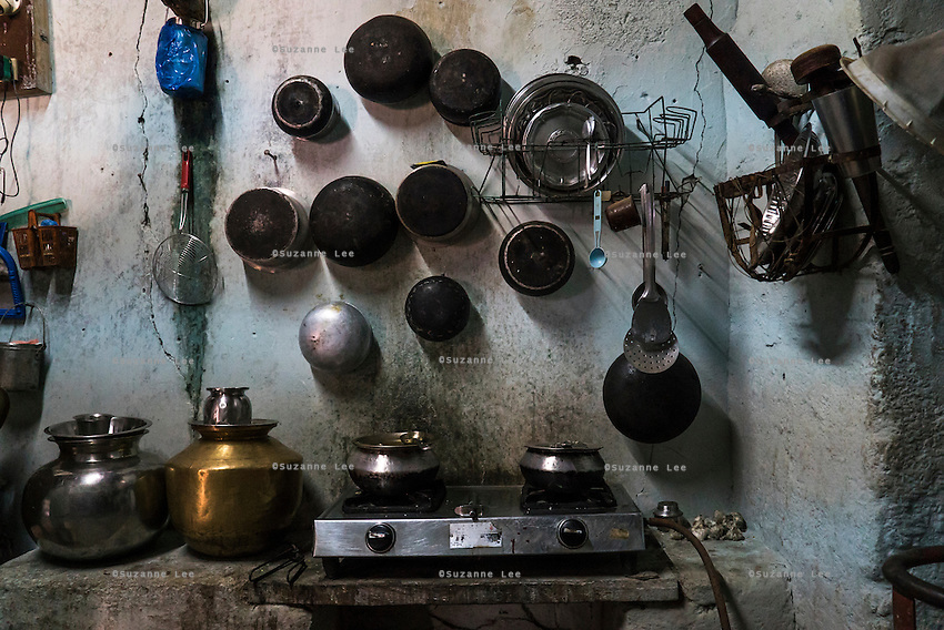 Cheekata Srujana's grandmother's pots and utensils hand on their kitchen wall in Peddapur, a remote village in Warangal, Telangana, India, on 22nd March 2015. Cheekata only uses safe water for all her cooking and drinking needs of the family. Photo by Suzanne Lee/Panos Pictures for Safe Water Network