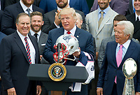 United States President Donald J. Trump, center, hold up the helmet he received from New England Patriots head coach Bill Belichick, left, during the ceremony welcoming the Super Bowl Champions to the South Lawn of White House in Washington, DC on Wednesday, April 19, 2917.  Team owner Robert Kraft looks on from right.<br /> Credit: Ron Sachs / CNP/MediaPunch<br /> <br /> (RESTRICTION: NO New York or New Jersey Newspapers or newspapers within a 75 mile radius of New York City)