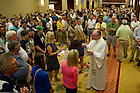 Jan. 6, 2013; Communion during Mass at the Intercontinental Hotel Ballroom in Miami. Photo by Barbara Johnston/University of Notre Dame