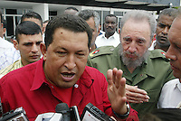 "Photo File/ Cuban President Fidel Castro (right), and Venezuelan Hugo Chavez talk with the press minutes before send off  in the international airport ""Jose Marti"", Tuesday August 23, 2005. Credit: Jorge Rey/MediaPunch"