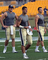 Pitt quarterbacks Mark Myers (left), Tino Sunseri (center) and Trey Anderson warm up.  The Notre Dame Fighting Irish defeated the Pitt Panthers 15-12 at Heinz field in Pittsburgh, Pennsylvania on September 24, 2011.
