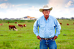 In Ocala, Florida a portrait of rancher E.L. Strickland on the Circle Square Ranch with cattle and housing development in background.  Photographed for Progressive Farmer Magazine.