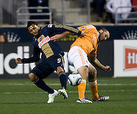 Carlos Valdes (5) of the Philadelphia Union fights for the ball with Will Bruin (12) of the Houston Dynamo during the game at PPL Park in Chester, PA.  Houston defeated Philadelphia, 2-1, to take home the one goal advantage in the home and home series..