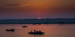Boats float on the Ganges at sunset, Varanasi, India