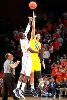 CHARLOTTESVILLE, VA- NOVEMBER 29: Jordan Morgan #52 of the Michigan Wolverines reaches for the tip off with Assane Sene #5 of the Virginia Cavaliers during the game on November 29, 2011 at the John Paul Jones Arena in Charlottesville, Virginia. Virginia defeated Michigan 70-58. (Photo by Andrew Shurtleff/Getty Images) *** Local Caption *** Assane Sene;Jordan Morgan
