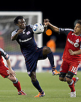 New England Revolution forward Kenny Mansally (7) attempts to control the ball as Toronto FC midfielder Oscar Cordon (16) pressures. In a Major League Soccer (MLS) match, the New England Revolution tied Toronto FC, 0-0, at Gillette Stadium on June 15, 2011.