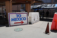 Nogales, Arizona - A sign located on the international U.S.-Mexico border points the way to Mexico from the U.S.'s side. This area is near the Border Patrol Nogales station, one of eight in the Tucson Sector, which is the busiest on the U.S.-Mexico border for illegal immigration, drug smuggling and border deaths. Photo by Eduardo © 2012