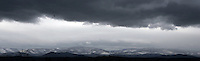 Winter weather clouds loom over the snow covered Blue Ridge Mountains.