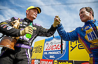 Jul 10, 2016; Joliet, IL, USA; NHRA funny car driver Jack Beckman (left) is congratulated by runner up, teammate Ron Capps after winning the Route 66 Nationals at Route 66 Raceway. Mandatory Credit: Mark J. Rebilas-USA TODAY Sports