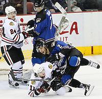 San Antonio Rampage's Michael Caruso (2) takes down Rockford Icehogs' Philippe Paradis (11) during the second period of an AHL hockey game, Saturday, Jan. 14, 2012, in San Antonio. (Darren Abate/pressphotointl.com)