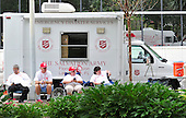 Salvation Army volunteers sit idle near an empty park authorized for peaceful protests at the 2012 Republican National Convention in Tampa Bay, Florida on Saturday, August 25, 2012..Credit: Ron Sachs / CNP.(RESTRICTION: NO New York or New Jersey Newspapers or newspapers within a 75 mile radius of New York City)