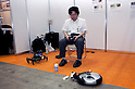 May 131, 2012, Tokyo, Japan - An exhibitor controls a small robot. The Smart Grid Exhibition and Automotive Next Industry Fair 2012 shows the next generation of vehicles and manufacturing working with eco energy, from May 30th. to June 1st. at Tokyo Big Site.