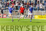 The Skill of Solo: Kenmare's Sean O'Leary solos upfield past Sean Sheehan   and John Rice Templenoe  during the County Intermediate Championship final in Fitzgerald Stadium on Sunday