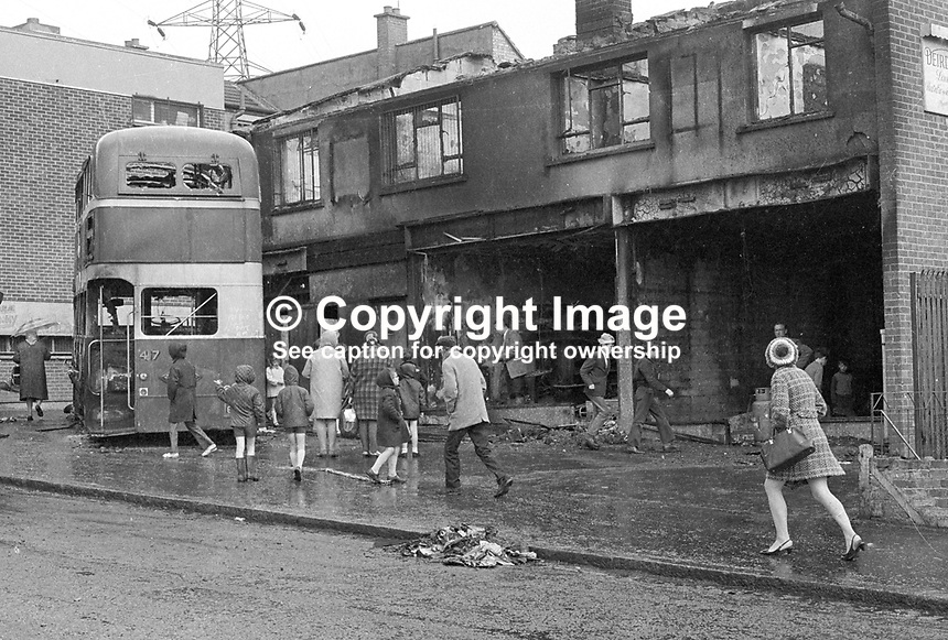 Burnt-out doubledecker bus in front of burnt out Belfast, N Ireland, UK, shops following a bout of rioting. 197006270237c...Copyright Image from Victor Patterson, 54 Dorchester Park, Belfast, UK, BT9 6RJ..Tel: +44 28 9066 1296.Mob: +44 7802 353836.Voicemail +44 20 8816 7153.Skype: victorpattersonbelfast.Email: victorpatterson@mac.com.Email: victorpatterson@ireland.com (back-up)..IMPORTANT: If you wish to use this image or any other of my images please go to www.victorpatterson.com and click on the Terms & Conditions. Then contact me by email or phone with the reference number(s) of the image(s) concerned.