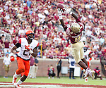 Florida State wide receiver Kermit Whitfield can't hang on to a pass in the endzone as Syracuse safety Chauncey Scissum looks on in the second half of an NCAA college football game in Tallahassee, Fla., Saturday, Oct. 31.  Florida State defeated Syracuse 45-21. (AP Photo/Mark Wallheiser)