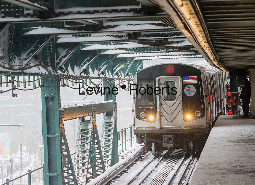 An Astoria Line train arrives at the Queensboro Plaza station in New York during the city's first major winter storm of the season on Thursday, February 9, 2017. Meteorologists are forecasting between 8 and 14 inches of snow in the New York City region. The Metropolitan Transportation Authority has had no major delays and the trains continue to run.  (© Richard B. Levine)