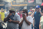 May 5, 2012; Commerce, GA, USA: NHRA fans in the pits cover their faces as a car warms up during qualifying for the Southern Nationals at Atlanta Dragway. Mandatory Credit: Mark J. Rebilas-